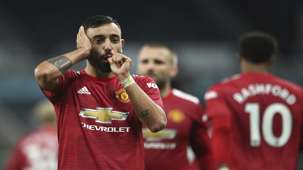 Manchester United's Bruno Fernandes celebrates after scoring during the English Premier League football match against Newcastle United  at St. James' Park in Newcastle, England, Saturday, Oct. 17, 2020. (Alex Pantling/Pool via AP).