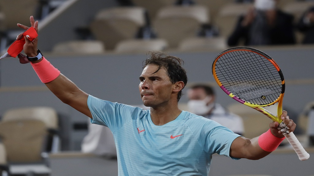 Spain's Rafael Nadal celebrates victory against Mackenzie McDonald of the US in round two of the French Open tennis tournament at the Roland Garros stadium in Paris, France, Wednesday, Sept. 30, 2020.