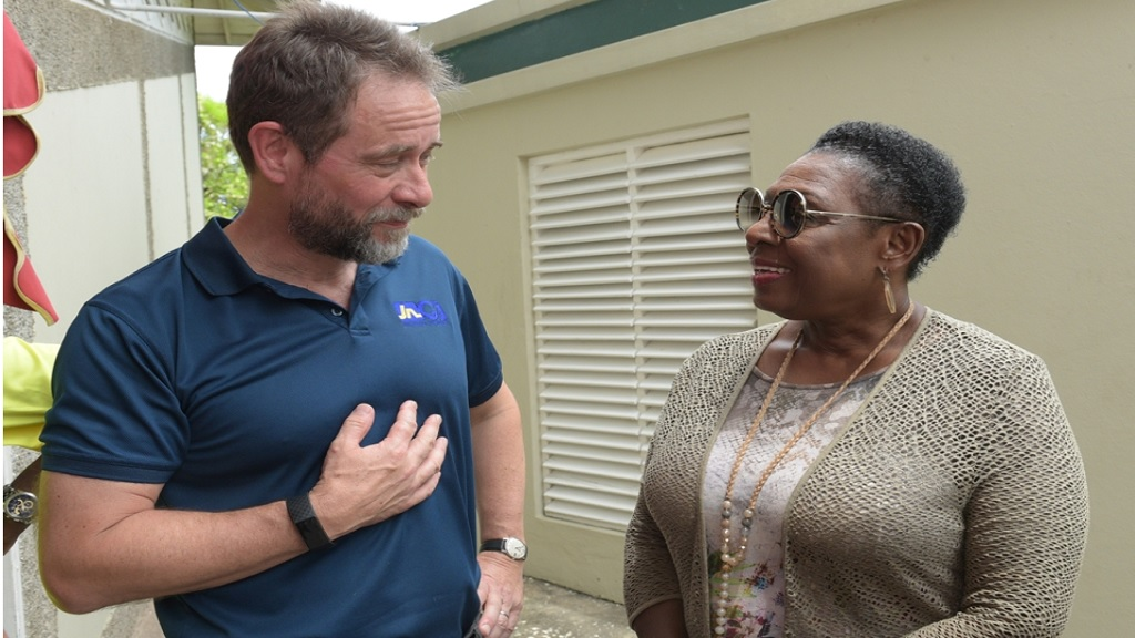 Chris Hind, (left) president of the Jamaica Squash Association, is seen here in conversation with Sports Minister Olivia Grange last July when the minister met with the national junior team just ahead of its departure for the 2019 CASA Junior Championships in Trinidad and Tobago.