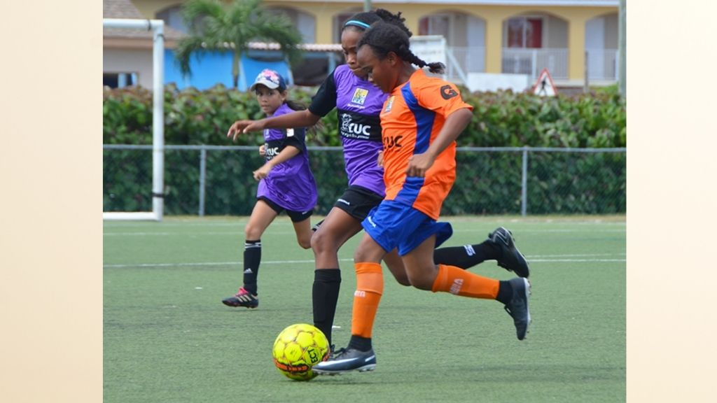 Theoline L. McCoy Primary's Jada Dixon-Lam (orange) seen here against St. Ignatius Catholic, scored three times against Sir John A. Cumber Primary to open the 2020 CUC GPFL season.