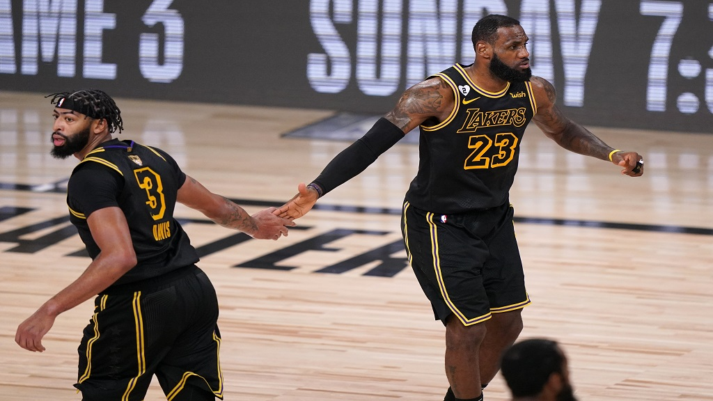 Los Angeles Lakers' Anthony Davis (3) and LeBron James (23) celebrate a basket against the Miami Heat during the second half of Game 2 of basketball's NBA Finals, Friday, Oct. 2, 2020, in Lake Buena Vista, Fla. (AP Photo/Mark J. Terrill).