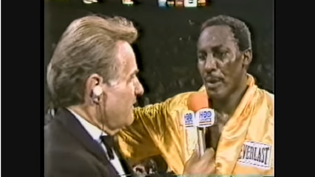 Mike McCallum (right) being interviewed by Larry Merchant after winning the vacant WBA junior middleweight title on October 19, 1984.