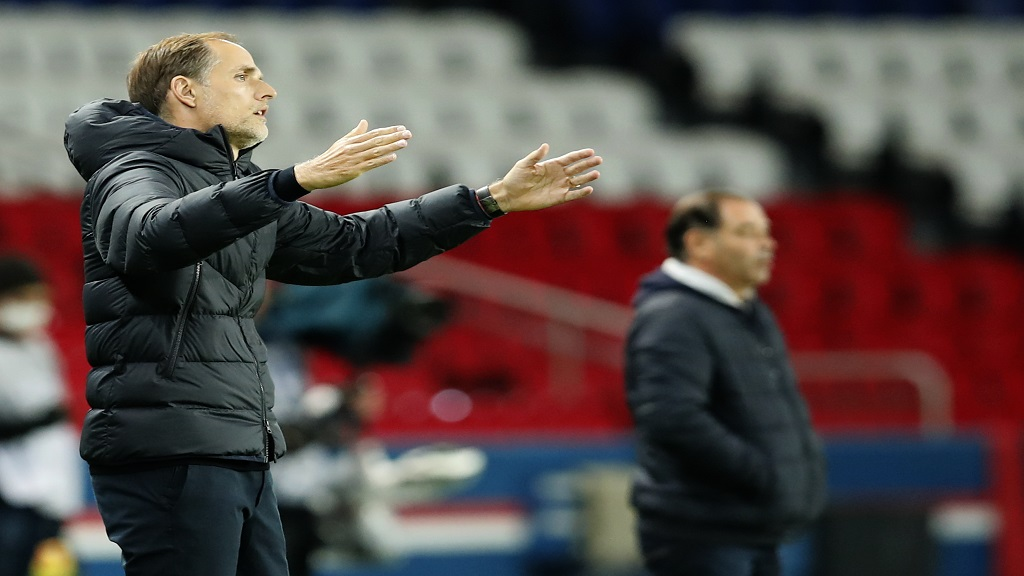PSG's head coach Thomas Tuchel gestures as he stands on the touchline during the French League One football match against Angers at the Parc des Princes in Paris, France, Friday, Oct. 2, 2020. (AP Photo/Francois Mori).