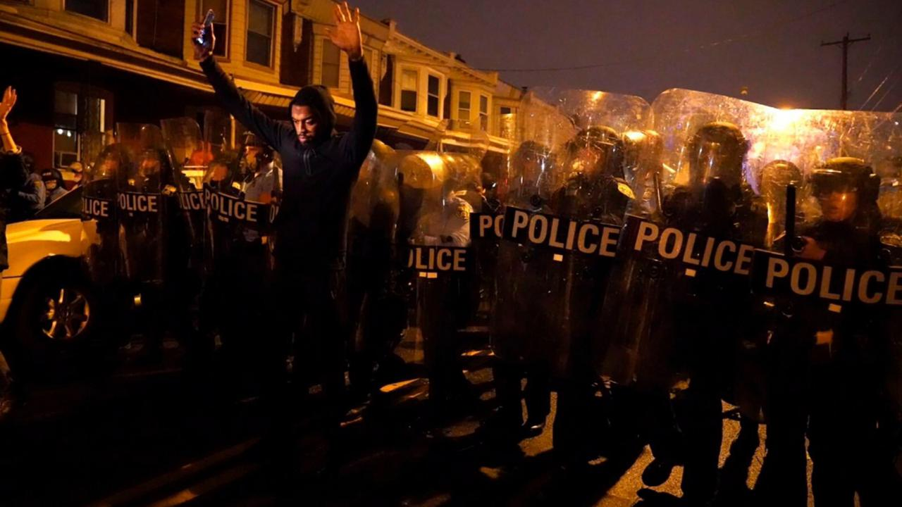 Sharif Proctor lifts his hands up in front of the police line during a protest in response to the police shooting of Walter Wallace Jr., Monday, October 26, 2020, in Philadelphia. Police officers fatally shot the 27-year-old Black man during a confrontation Monday afternoon in West Philadelphia that quickly raised tensions in the neighbourhood. (Jessica Griffin/The Philadelphia Inquirer via AP)