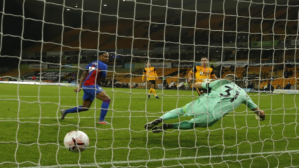 Wolves' Daniel Podence, right, scores his side's second goal during the English Premier League football match against Crystal Palace at the Molineux Stadium in Wolverhampton, England, Friday, Oct, 30, 2020. (Andrew Boyers/Pool via AP).