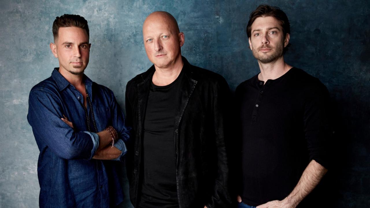 James Safechuck, from right, director Dan Reed and Wade Robson pose for a portrait to promote the film