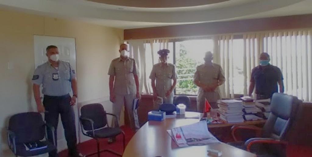 Senior Superintendent Gaffar, Assistant Superintendent John, Superintendent Doodhai and Acting Inspector Mohammed meet with Naparima MP.