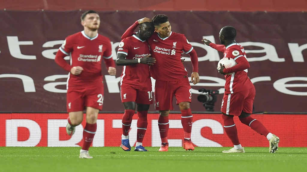Liverpool's Sadio Mane, second left congratulated by teammates after scoring his team's first goal during the English Premier League football match against Arsenal at Anfield in Liverpool, England, Monday, Sept. 28, 2020. (Paul Ellis/Pool via AP).