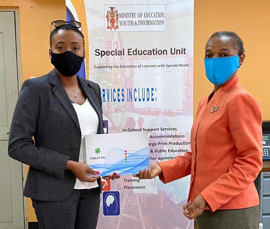Founder and Managing Director of Day and Night Beauty, Daenia Ashpole (left) presents Marcia McDonald, Principal of Carberry Court Special School with the donation of tablet computers to assist with online classes.