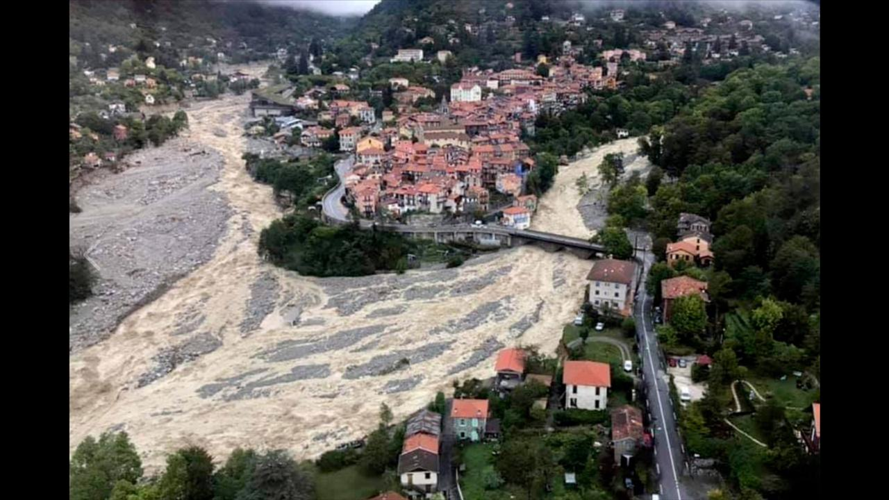 This aerial view provided Sunday October 4, 2020 by the Alpes Maritimes region fire brigade show a house keeping a fragile balance on a hill while a river floods Saturday October 3. 2020 near La Vesubie, southern France.  (SDIS 06 via AP)