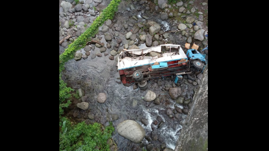 The crashed truck lying in the rocky bed of the Wag Water River in Devon Pen, St Mary on Friday.