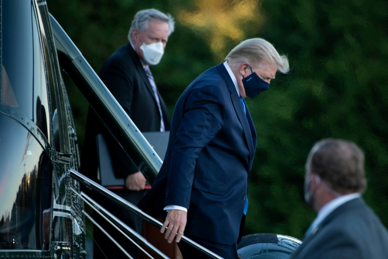 FILE - In this Friday, October 2, 2020, file photo, President Donald Trump steps down from Marine One as he arrives at Walter Reed National Military Medical Center in Bethesda, Md., after he tested positive for COVID-19. (AP Photo/Jacquelyn Martin, File)