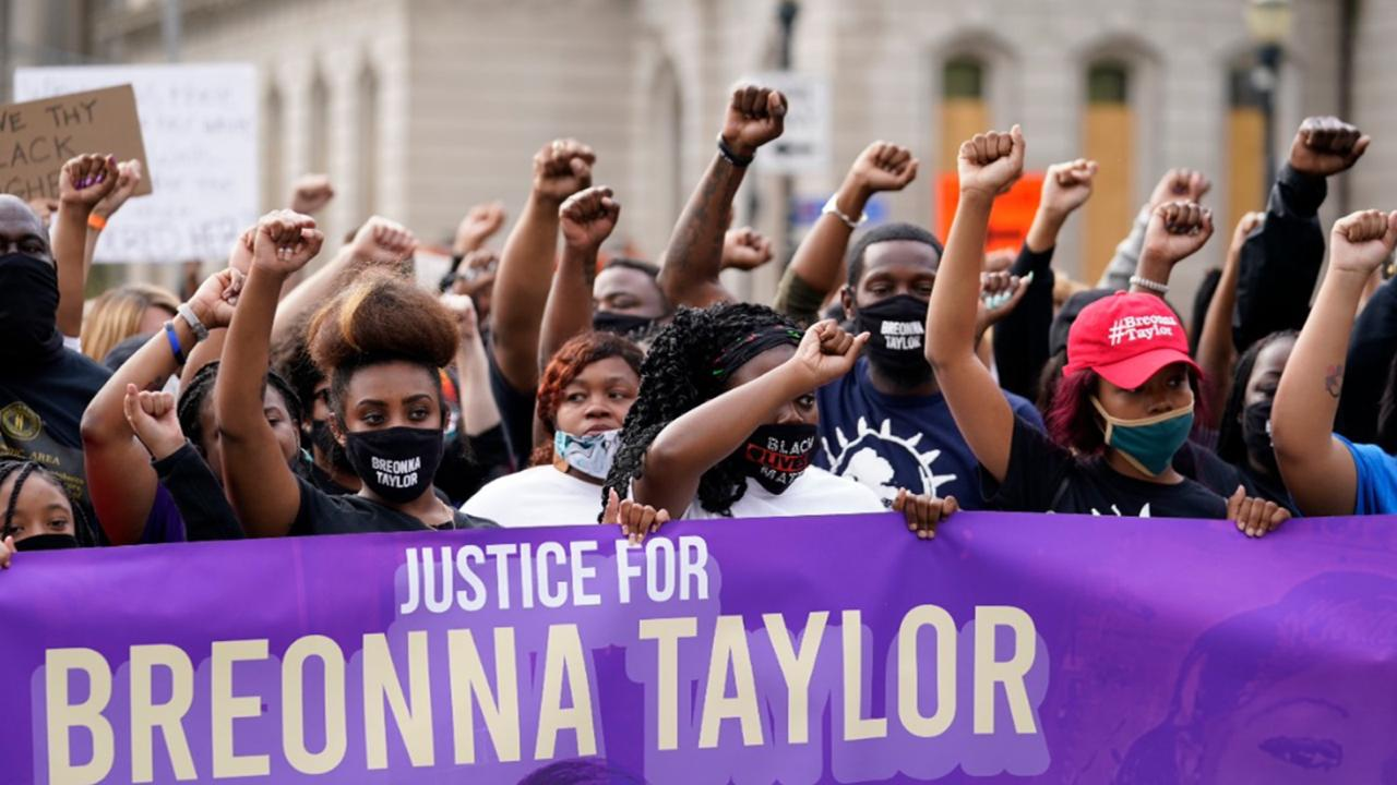 In this September 25, 2020, file photo, Black Lives Matter protesters march in Louisville. Hours of material in the grand jury proceedings for Taylor's fatal shooting by police have been made public on Friday, October 2. (AP Photo/Darron Cummings, File)