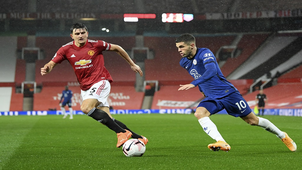 Chelsea's Christian Pulisic, right, duels for the ball with Manchester United's Harry Maguire during their English Premier League football match, at the Old Trafford stadium in Manchester, England, Saturday, Oct. 24, 2020. (Michael Regan/Pool via AP).