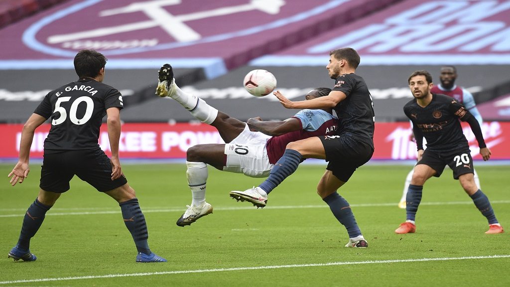 West Ham's Michail Antonio scores his side's opening goal during the English Premier League football match against Manchester City, at the London Olympic Stadium Saturday, Oct. 24, 2020. (Justin Tellis, Pool via AP).