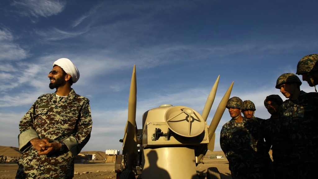 In this November 13, 2012 file photo, an Iranian clergyman stands next to missiles and army troops, during a manoeuvre, in an undisclosed location in Iran. Photo: Majid Asgaripour/Mehr News Agency via AP, File