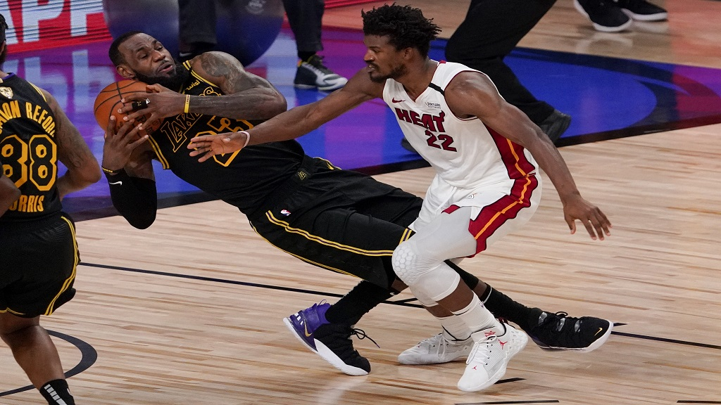 Los Angeles Lakers forward LeBron James pulls rebound away from Miami Heat forward Jimmy Butler during the second half in Game 5 of basketball's NBA Finals Friday, Oct. 9, 2020, in Lake Buena Vista, Fla. (AP Photo/Mark J. Terrill).