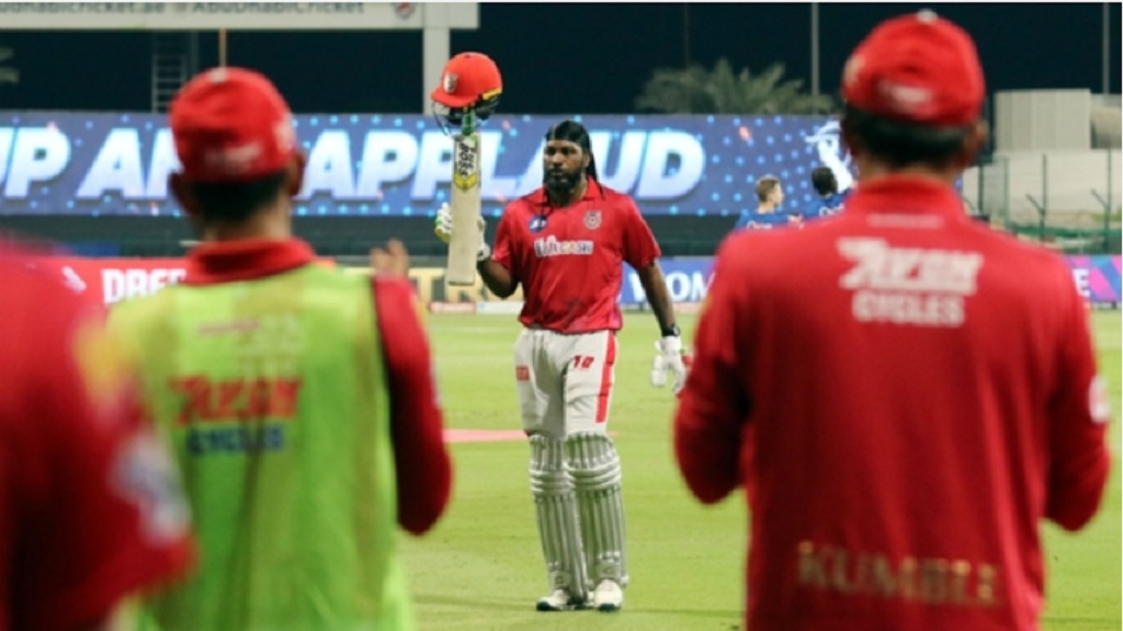 Chris Gayle walks off after being dismissed for 99.
