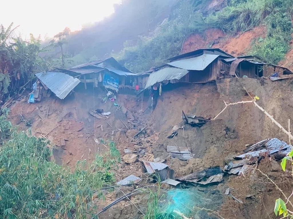 A landslide damages houses in a village in Phuoc Loc district, Quang Nam province, Vietnam Thursday, October 29, 2020. Three separated landslides triggered by Typhoon Molave killed more than a dozen villagers in the province as rescuers scramble to recover more victims. (Lai Minh Dong/VNA via AP)