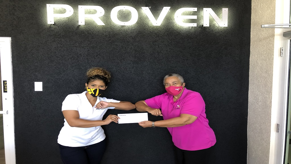 Jhenelle Lawrence-Manager, Client Experience poses with Carolind Graham, President of Jamaica Reach to Recovery after receiving annual donation.