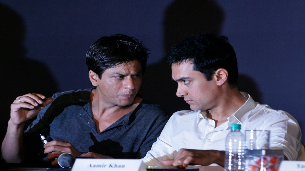 In this April 7, 2009, file photo, Bollywood actors Shah Rukh Khan, left, and Aamir Khan speak during a press conference in Mumbai, India. Photo: AP Photo/Rajanish Kakade, File