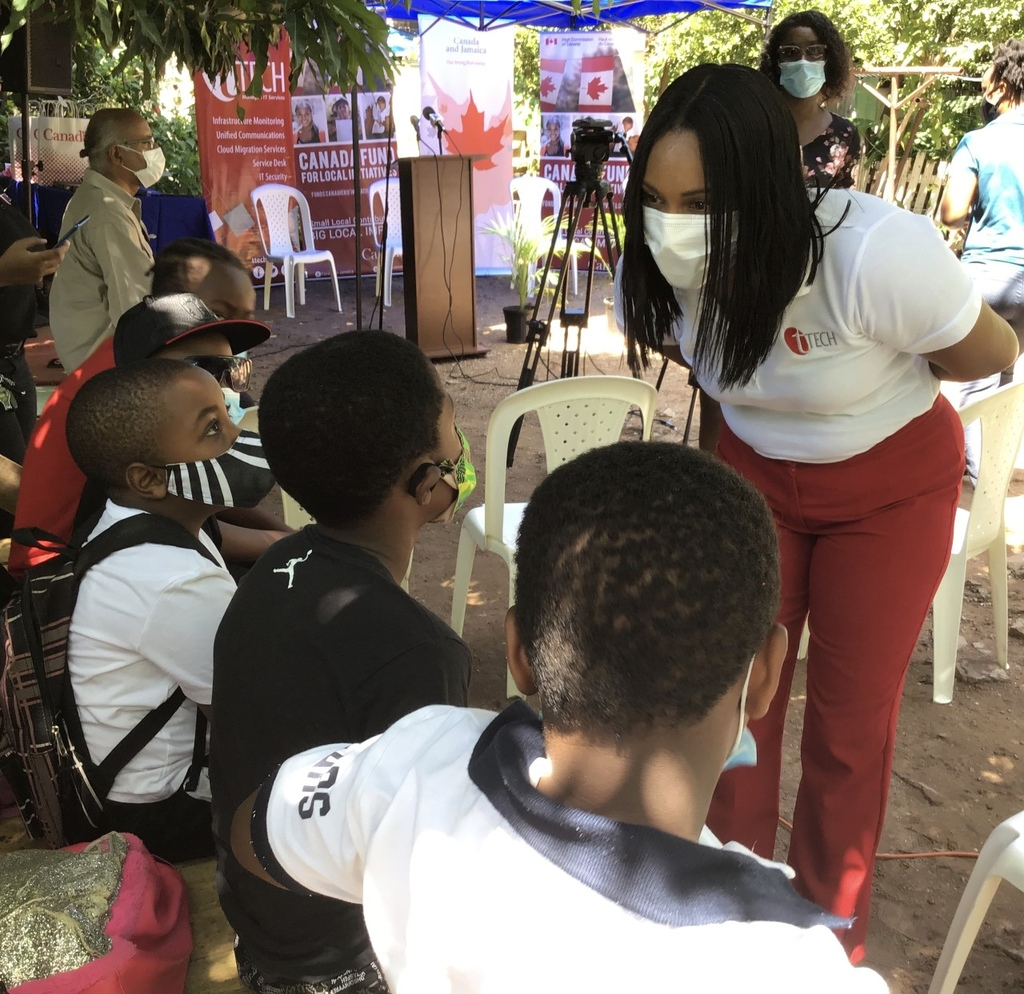 Tech Limited Marketing & HR Manager, Gillian Murray, in conversation with male students about their experience with the City Kids Homeschool Cluster at Southside Parade Gardens.