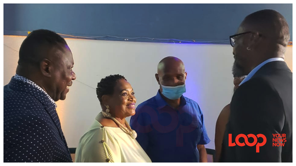 Former Minister Steven Blackett (left) introduces his wife (second from left) to DLP St George North candidate Floyd Reifer (right).