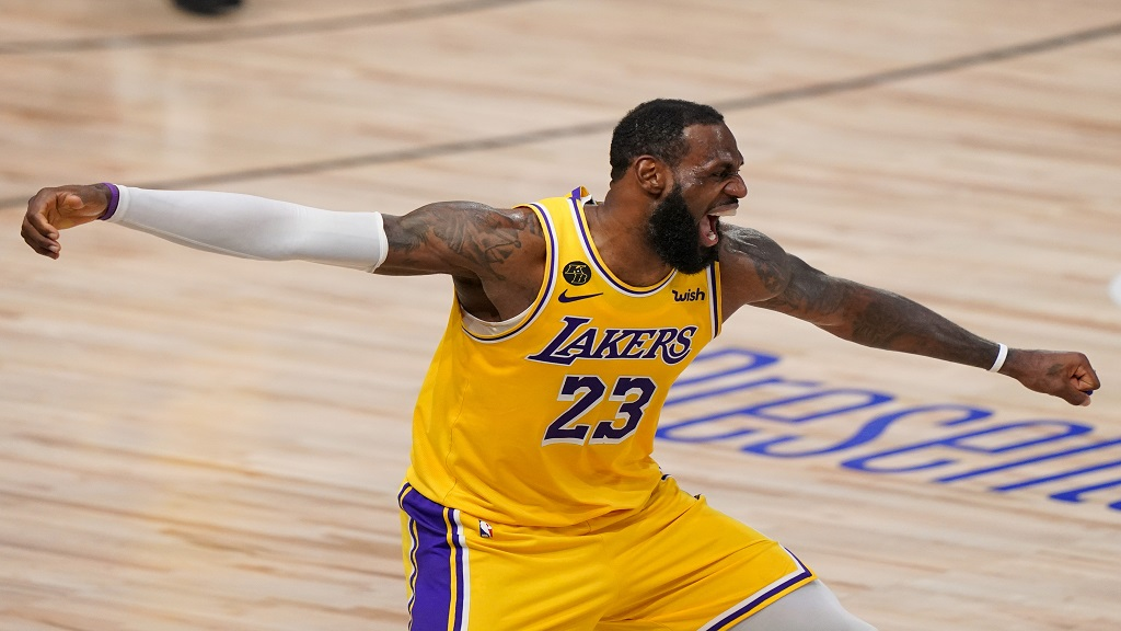 Los Angeles Lakers forward LeBron James celebrates during the second half in Game 4 of basketball's NBA Finals against the Miami Heat Tuesday, Oct. 6, 2020, in Lake Buena Vista, Fla. (AP Photo/Mark J. Terrill).