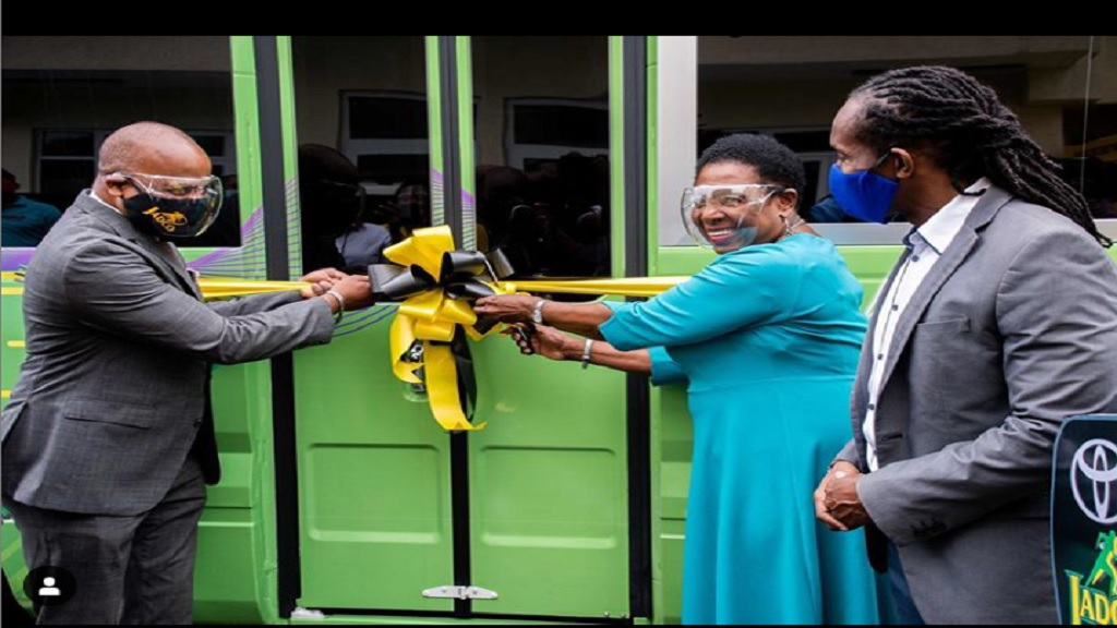 Sport Minister Olivia Grange (2nd right) cuts the ribbon on Jamaica's first-ever anti-doping mobile unit during a special ceremony on Wednesday, September 30, 3030. Looking on are the Minister of State in the Ministry of Culture, Gender, Entertainment and Sport, Alando Terrelonge (right) and the chairman of the Jamaica Anti-Doping Commission, Alexander Williams.