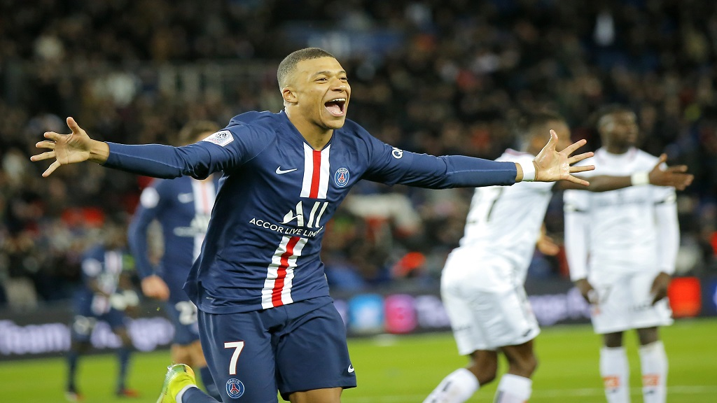 In this Feb.29, 2020 file photo, PSG's Kylian Mbappe celebrates after scoring his side's fourth goal during the French League One football match against Dijon, at the Parc des Princes stadium in Paris. Paris Saint-Germain have been declared French league champion after the football season ended early because of the coronavirus pandemic. (AP Photo/Michel Euler, File).