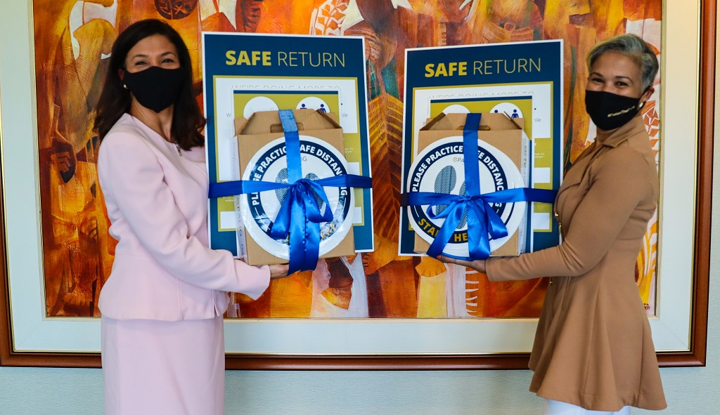 Gretchen Camacho-Mohammed, Managing Director of RBC Royal Bank Trinidad and Tobago, and Greer Quan, CEO, Pan-American Life Insurance Group, display samples of the COVID-19 care package that will be distributed to small businesses.