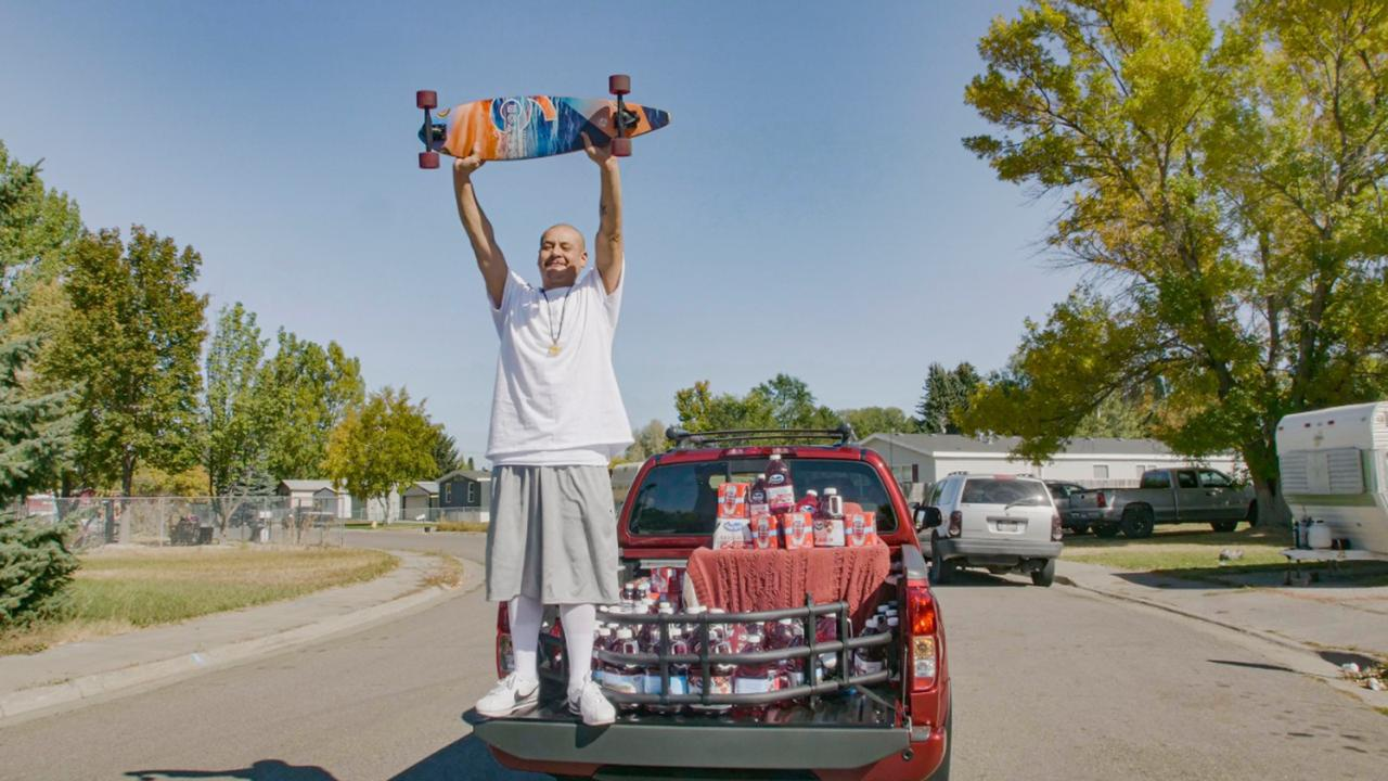 This October 6, 2020 photo released by Ocean Spray shows Nathan Apodaca holding his skateboard while standing in the back of a truck with Ocean Spray products in Idaho Falls, Idaho. (Wesley White/Ocean Spray via AP)