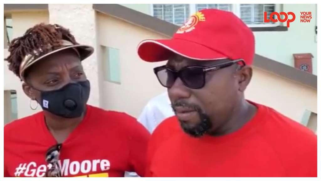 Minister of Youth, Sports and Community Empowerment Dwight Sutherland flanked by BLP candidate for St George North Toni Moore