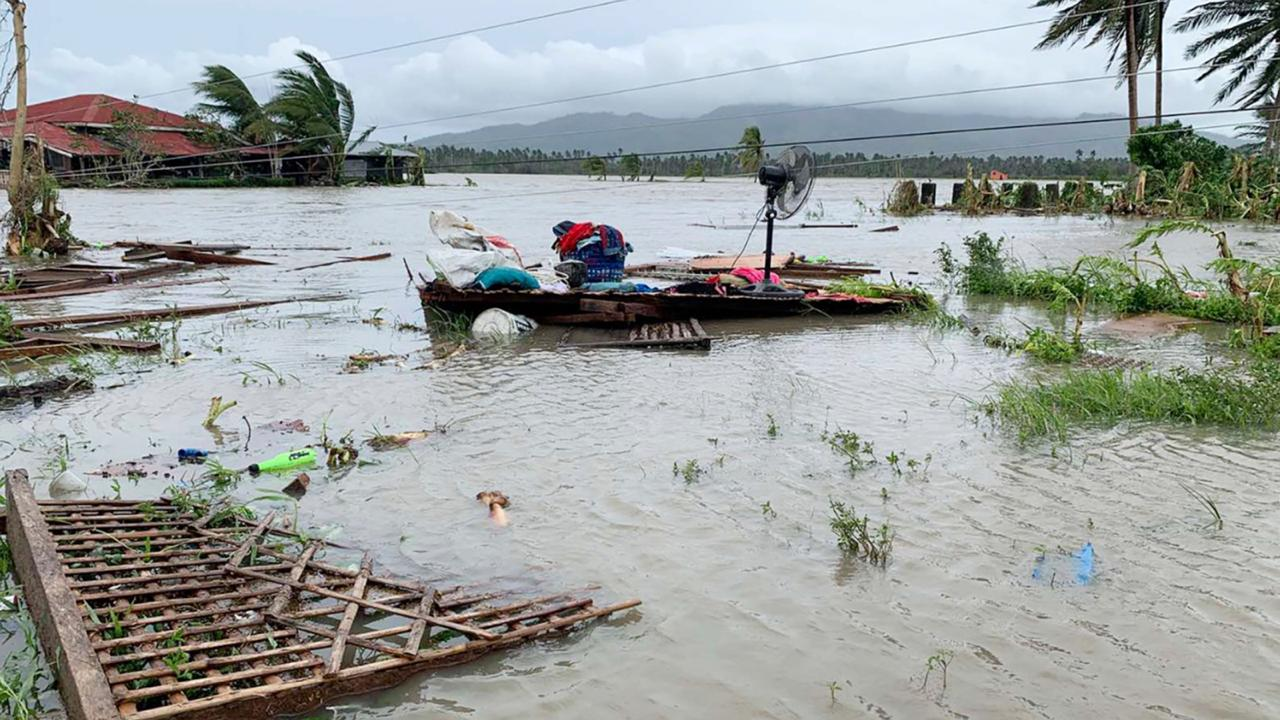 The remains of a house is surrounded by floods in Pola town on the island of Mindoro, central Philippines, Monday, October 26, 2020. A fast-moving typhoon forced thousands of villagers to flee to safety in provinces south of the Philippine capital Monday, flooding rural villages and ripping off roofs, officials said. (AP Photo/Erik De Castro)