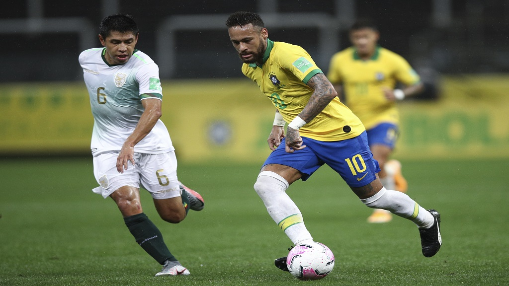 Brazil's Neymar, right, runs with the ball as Bolivia's Diego Wayar challenges him during a qualifying football match for the FIFA World Cup Qatar 2022 at the Neo Quimica arena in Sao Paulo, Brazil, Friday, Oct. 9, 2020. (Buda Mendes/Pool via AP).