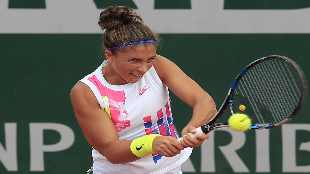 Italy's Sara Errani plays a shot against Netherlands' Kiki Bertens in the second round match of the French Open tennis tournament at the Roland Garros stadium in Paris, France, Wednesday, Sept. 30, 2020. (AP Photo/Michel Euler).