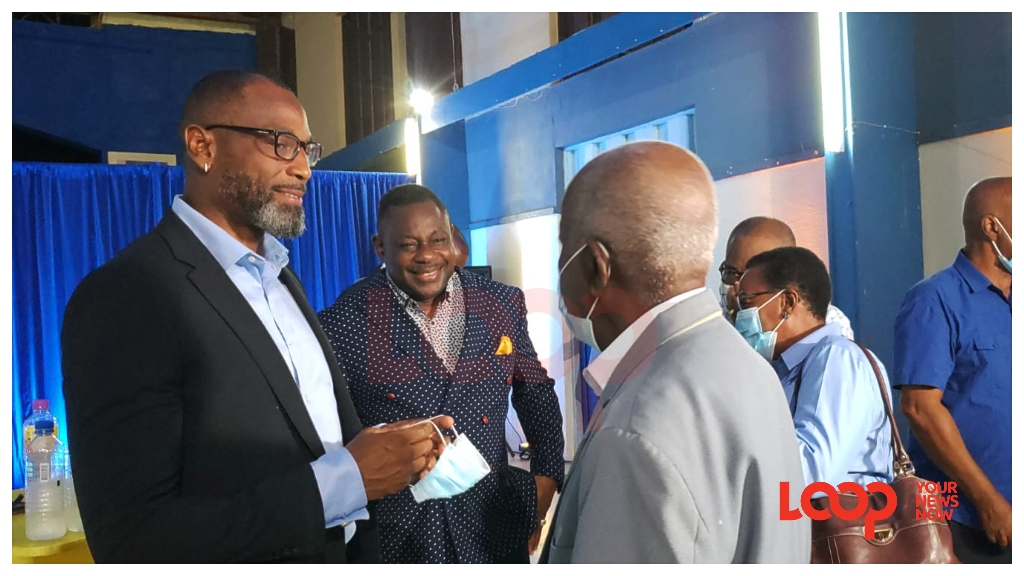 DLP Candidate for St George North chatting with a supporter as former DLP St Michael Central Steven Blackett looks on.