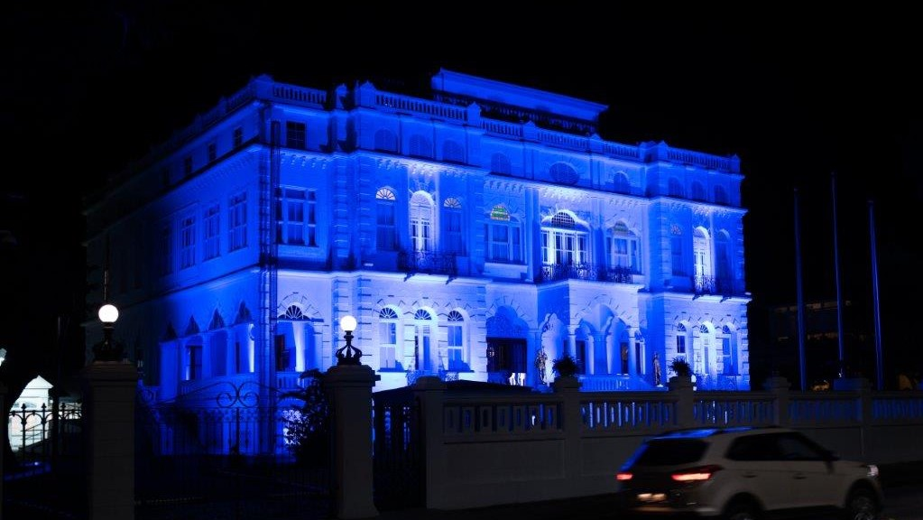 Whitehall in Port of Spain shines in blue for UN Day (via the UN Resident Coordinator's Office)
