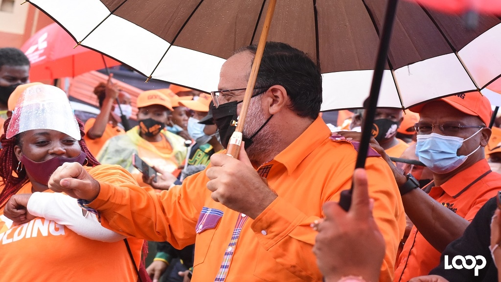 PNP presidential candidate Mark Golding (centre) elbow bumps a supporter. Golding's friend, former Central Manchester MP Peter Bunting (right) shares in the occasion. (Photos: Marlon Reid)