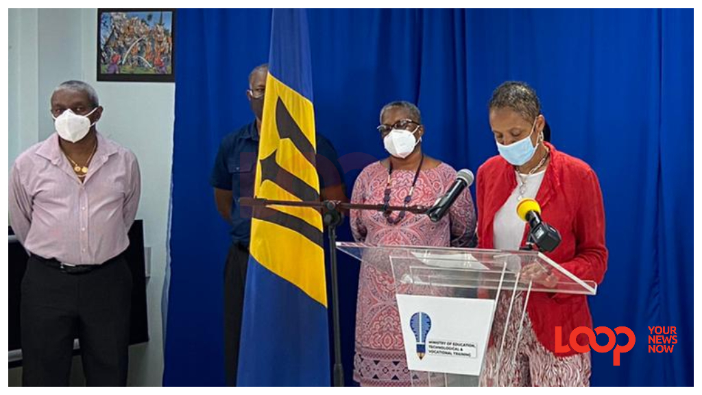 Minister of Education, Technological and Vocational Training, Santia Bradshaw at the podium during Sunday's press conference.