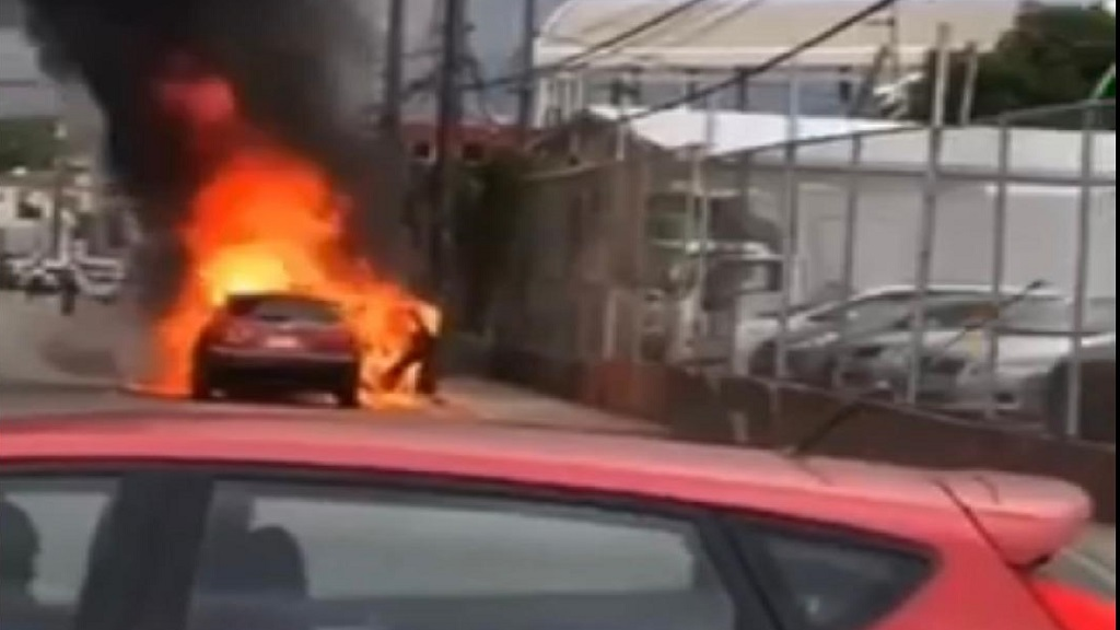 A screen grab from a video of a motor vehicle on fire in Half-Way Tree, St Andrew on Friday afternoon.