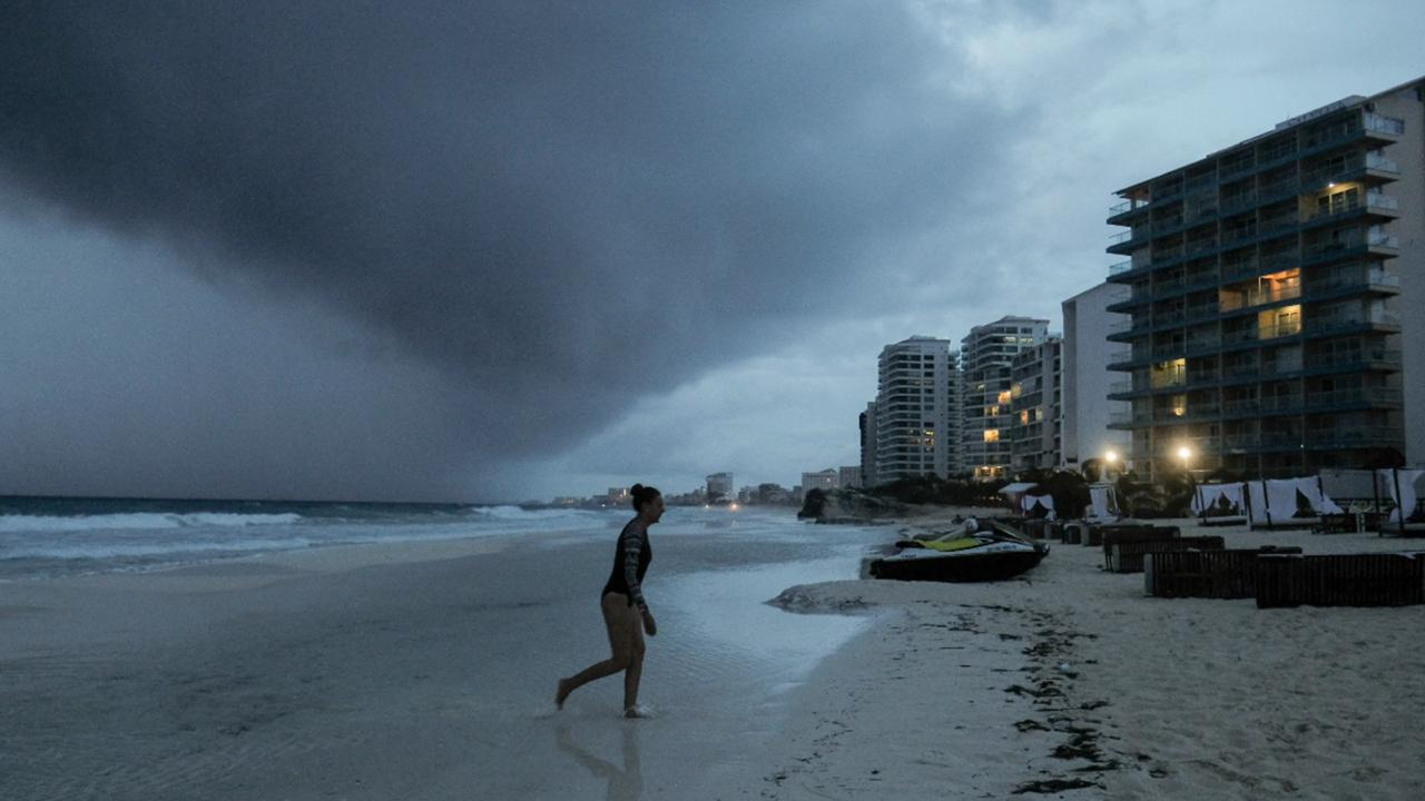 Clouds gather over Playa Gaviota Azul as Tropical Storm Zeta approaches Cancun, Mexico, Monday, October 26, 2020. A strengthening Tropical Storm Zeta is expected to become a hurricane Monday as it heads toward the eastern end of Mexico's resort-dotted Yucatan Peninsula and then likely move on for a possible landfall on the central US Gulf Coast at midweek. (AP Photo/Victor Ruiz Garcia)