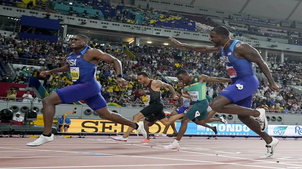 In this Sept. 28, 2019, file photo, Christian Coleman, of the United States, crosses the finish line to win the men's 100m final ahead of silver medalist Justin Gatlin, right, also of the United States, during the World Athletics Championships in Doha, Qatar. (AP Photo/David J. Phillip, File).