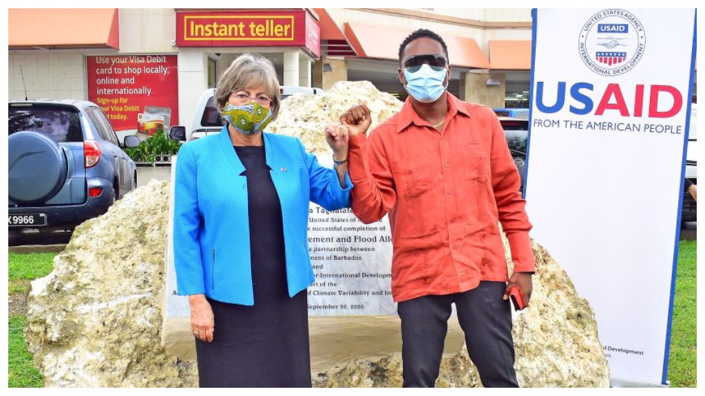 Minister of Environment and National Beautification, Adrian Forde and the United States Ambassador to Barbados, Linda Taglialatela, commemorate the completion of the flood alleviation project.