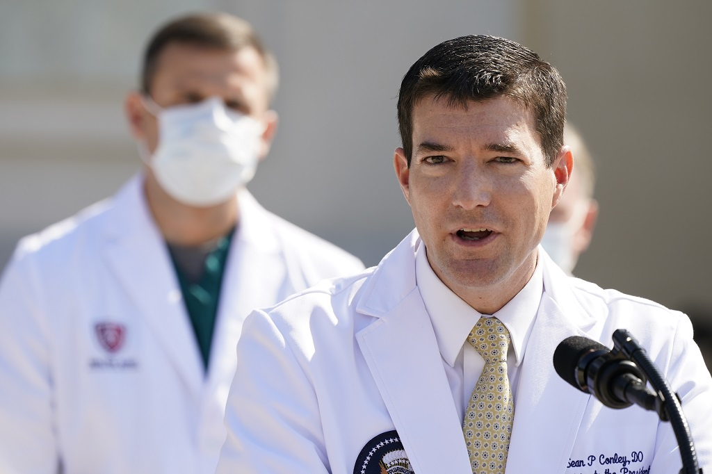 Dr Sean Conley, physician to President Donald Trump, briefs reporters at Walter Reed National Military Medical Center in Bethesda, Maryland, Sunday, October 4, 2020. Trump was admitted to the hospital after contracting the coronavirus. (AP Photo/Jacquelyn Martin)