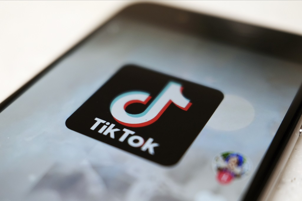 "FILE - This Monday, September 28, 2020, file photo, shows as logo of a smartphone app TikTok on a user post on a smartphone screen in Tokyo. Canadian e-commerce platform Shopify said Tuesday, October 27, 2020, it's made a deal with TikTok enabling merchants to create ""shoppable"" video ads that drive customers to online stores. (AP Photo/Kiichiro Sato, File)"
