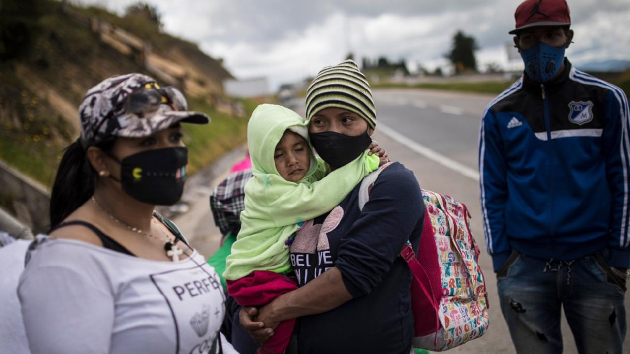 Venezuelan migrants rest as they walk towards Bogota, passing through Tunja, Colombia, Tuesday, October 6, 2020. Immigration officials in Colombia expect 200,000 Venezuelans to enter the country in the following months, enticed by the prospects of earning higher wages and sending money home to feed their families. (AP Photo/Ivan Valencia)