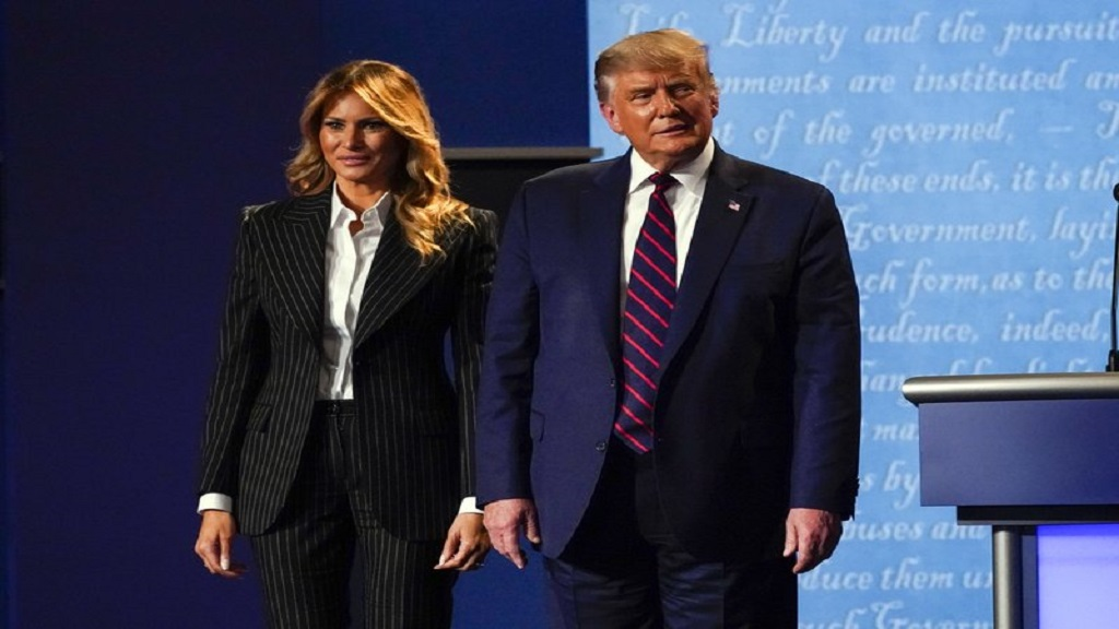 President Donald Trump stands on stage with first lady Melania Trump after the first presidential debate with Democratic presidential candidate, former Vice President Joe Biden on Tuesday, September 29, 2020 at Case Western University and Cleveland Clinic in Cleveland, Ohio (AP Photo/Julio Cortez)
