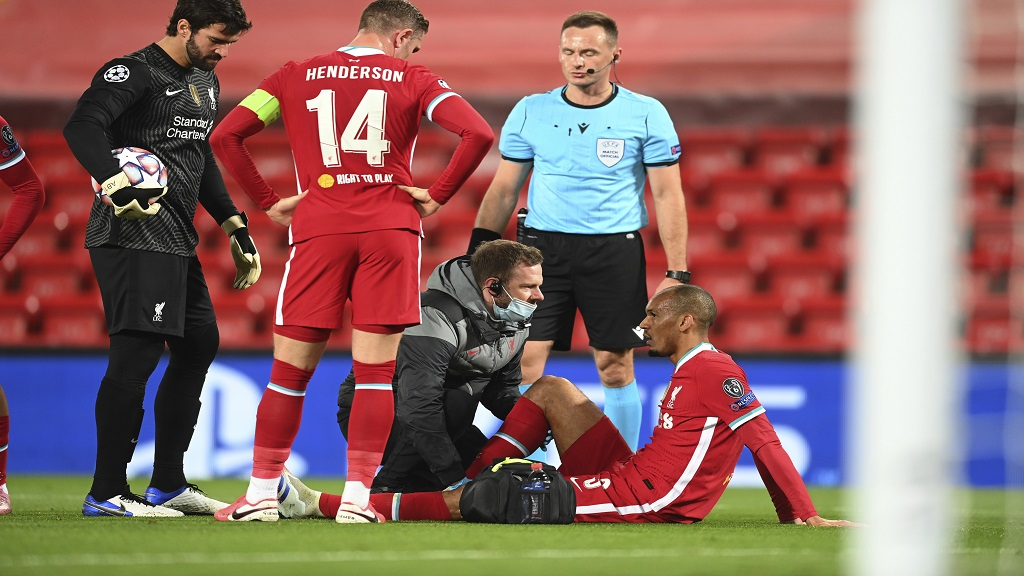 Liverpool's Fabinho sits with an injury before leaving the match during the Champions League Group D football match against Midtjylland at Anfield stadium, in Liverpool, England, Tuesday, Oct. 27, 2020. (Michael Regan/Pool via AP).