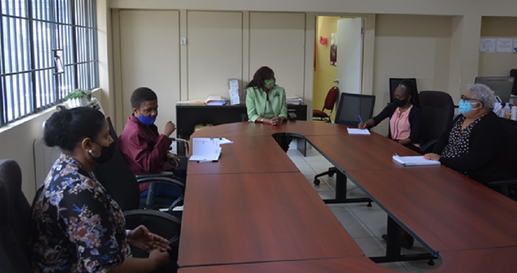 Minister of Social Development and Family Services Donna Cox meets with staff of the National Family Services Division.